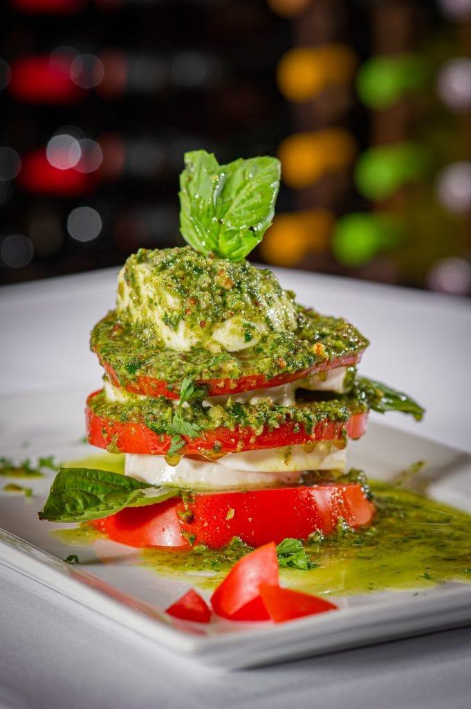 Capresto (Caprese salad with pesto, tomatoes, mozzarella, basil)