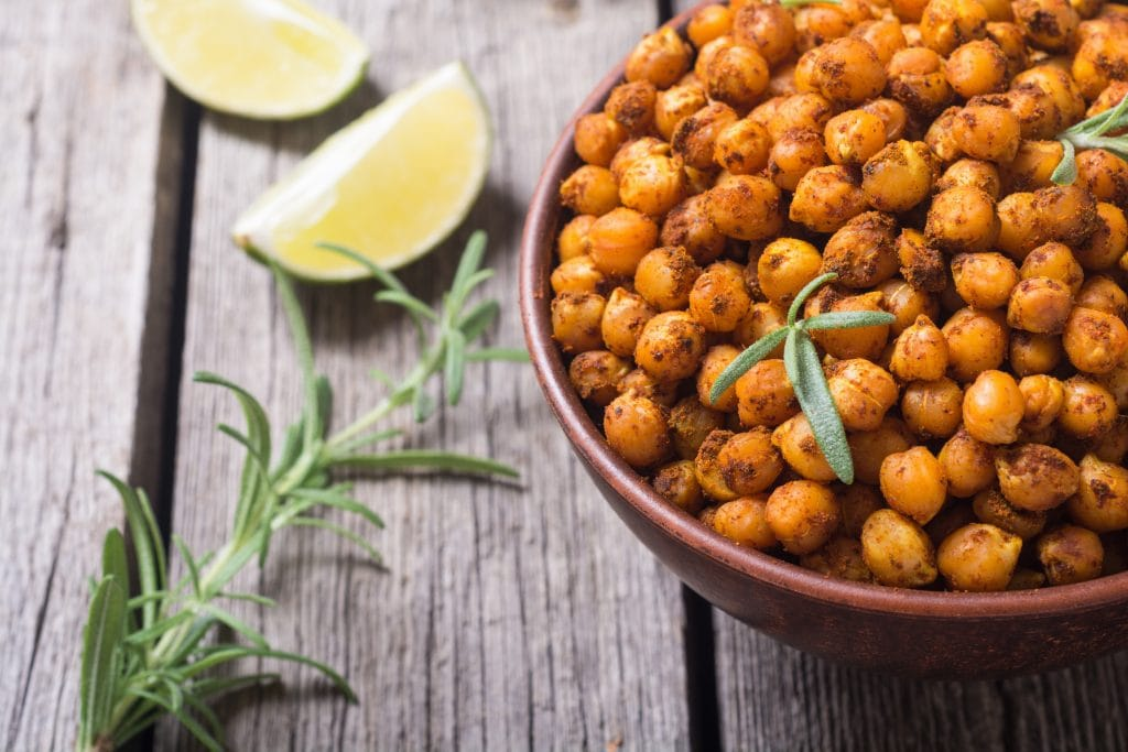Spicy roasted chickpeas with rosemary garnish