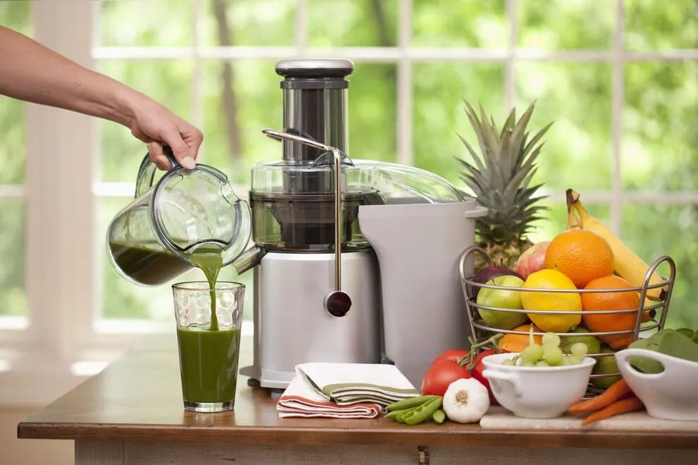 vegetable juice poured from a juicer, fruits and vegetables